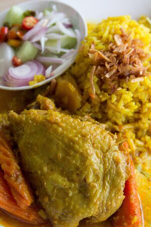 Chicken curry with yellow rice photo
