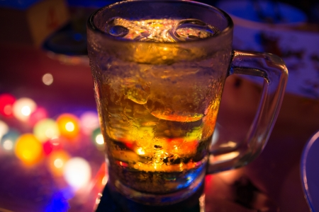 Glass of beer with night scene photo