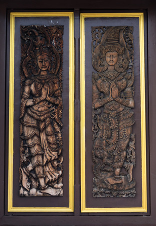 Door woodcarving in temple, Thailand photo