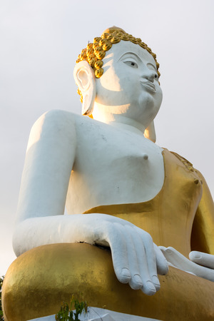 Statue of big Buddha in the temple Wat Doikam, Chiang Mai, Thailand photo