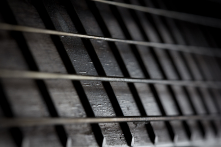 Acoustic Guitar with very shallow depth of field photo