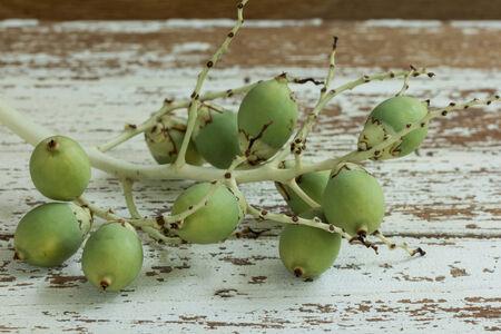 betel nut on wood