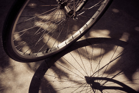 vintage bicycle wheel with shadow photo