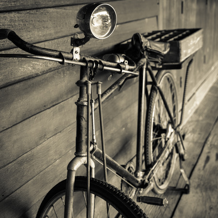 old classic bicycle on wooden background photo