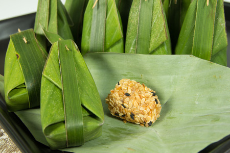 Thai sweets dessert in banana leaf photo