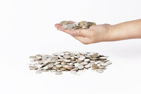 Mano con la moneda de dinero