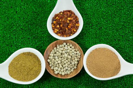 seasonings: herb seasonings in ceramic spoon and wooden cup