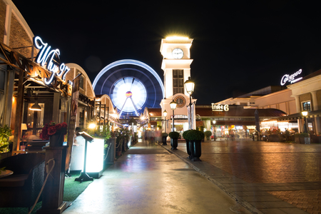 riverfront: Bangkok,Thailand-May 16,2015:Tourist visit Asiatique The Riverfront at night.Over 500 fashion boutiques housed in Factory District of Asiatique The Riverfront.