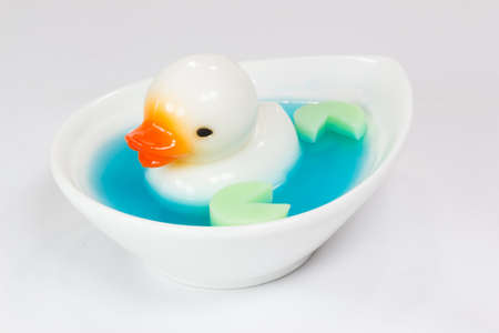 imitations: white duck coconut jelly in blue jelly Stock Photo