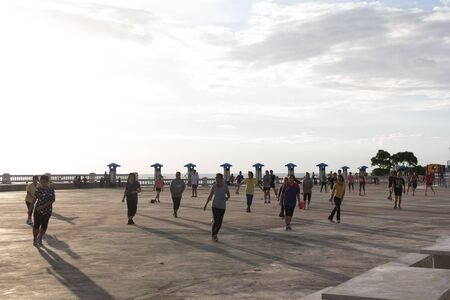 Chonburi,Thailand-June 29,2015:People dancing a fitness dance or aerobics in the park at evening. Editorial