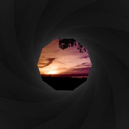 shutter aperture: Camera shutter aperture with nature landscape