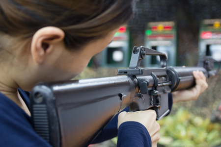 close up with a woman and gun fire