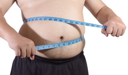 man measurement: Fat man holding a measurement tape isolated Stock Photo