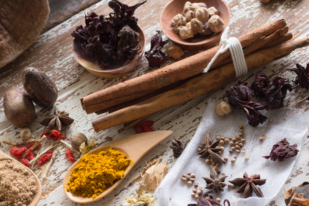 Herbs and spices on wood backgrpund