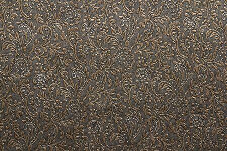 Golden floral ornament pattern on dark  background