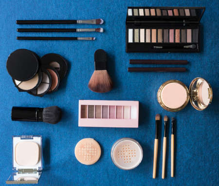 composition of the set of cosmetics on blue background