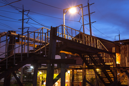 Old wood bridge with wooden frame and lighting in old town in the night