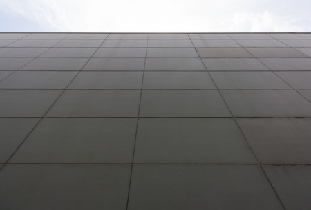 concrete facade of building with sky background Stock Photo