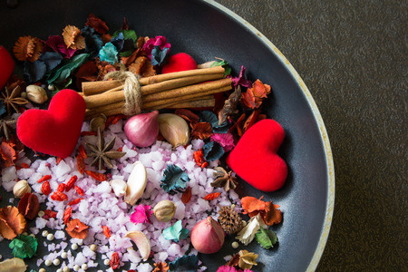 food ingredients with red heart and dry flower on pan