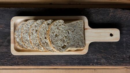 Homemade whole grain bread on wood background Stock Photo