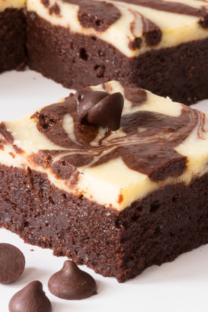 Cutting of Brownie Cheesecake set on wooden plate with chocolate chip