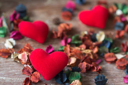 red heart shape  on wooden background with dry flowers Stock Photo