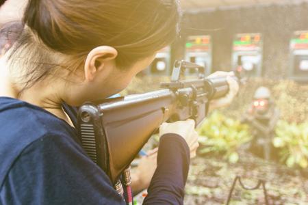 gun fire: close up with a woman and gun fire