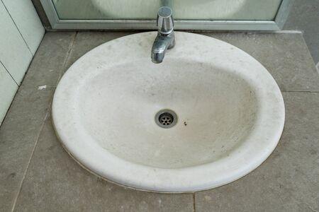 wash basin: Dirty wash basin in mens bathroom