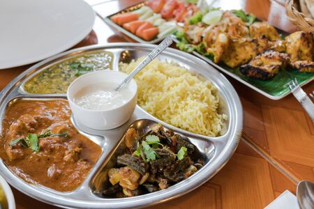 Madras: Set of Indian cuisine, Rice with curry and grilled chicken and yogurt sauce Stock Photo