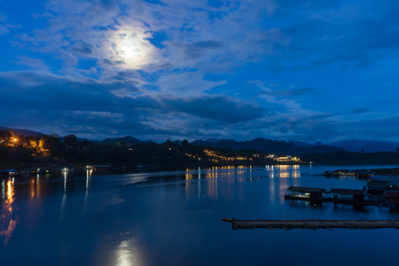 Floating village at night, view from the bridge  in Sangkhlaburi District, Kanchanaburi, Thailand.