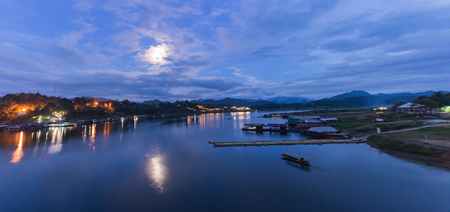 floating bridge: Floating village in the evening, Panorama view from the bridge  in Sangkhlaburi District, Kanchanaburi, Thailand.