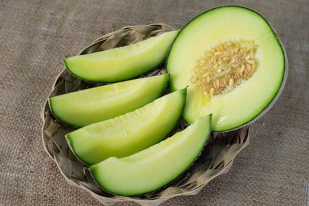 melons: Sliced of green melons in basket