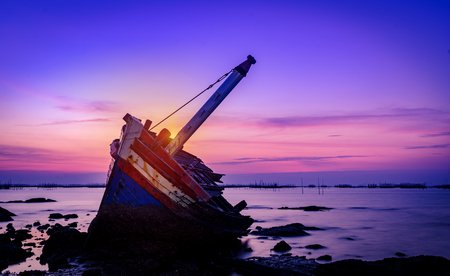 Shipwreck in Angsila Chonburi with sunset and twilight sky Stock Photo