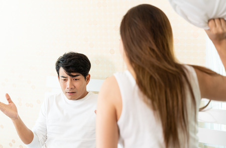 Disgruntled family couple quarreling each other in bedroom at home