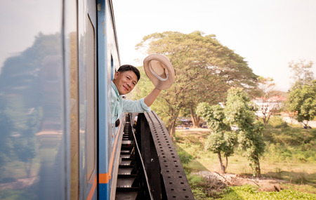 Happy smiling tourist  traveiing by train 免版税图像