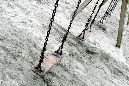 A set of old abandoned swings Stock Photo - 2060093