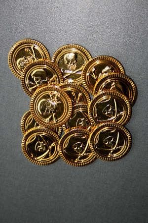 A load of golden coins with pirates mark printed on them