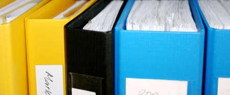 Plastic folders in a shelf