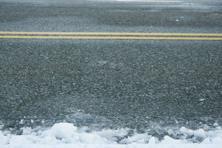 deterrent: winter road with ice and snow