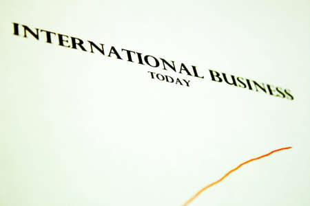 International business with red graph pointing upwards photo