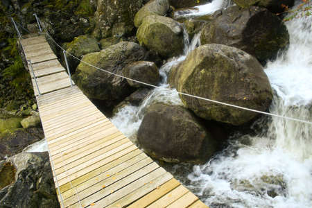 A pedestrian bridge across a river