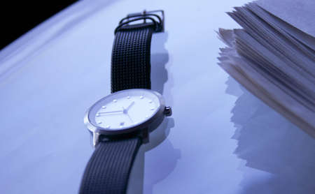 Wristwatch and paper