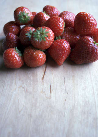 Fresh and juicy strawberry on a wooden table