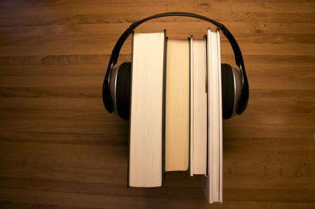 Headset and printed books illustrating audiobooks