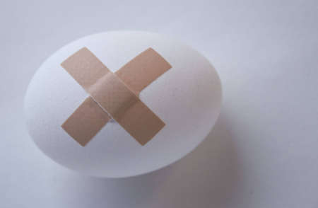 Egg with plaster Stock Photo