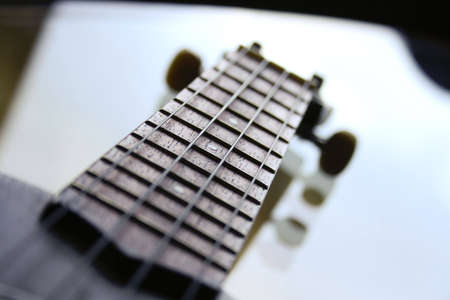 A guitar on a glass table Stock Photo