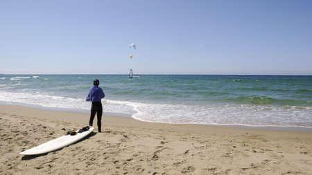 Windsurfer having a break at the beach
