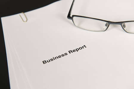 Business report and glasses Stock Photo