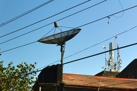 electric line: The satellite dish and electric line on the street