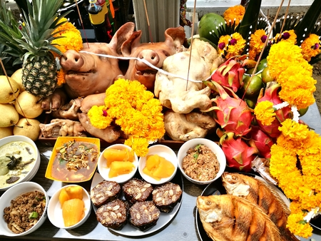 Pigs head and side dish to worship God is to give Him our love in the Traditions Of Thailand